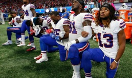 Buffalo Bills players take a knee during the national anthem before the first half of an NFL football game between the Atlanta Falcons and the Buffalo Bills, Sunday, Oct. 1, 2017, in Atlanta. (AP Photo/John Bazemore) ORG XMIT: GAMS102